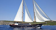 A crewed charter motor sailer 118ft cruising in Greece. Accommodation for 12 guests in 6 cabins.