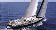 A crewed charter 33m rigged sloop sailing yacht built by Dynamique sailing in Greece. Accommodation for 12 guests in 5 cabins. White sailing yacht speeding across the Greek seas.