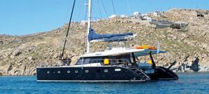 A 19m  Catamaran Sunreef 62, multihull yacht anchored in Myconos.